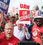 Sen. Bernie Sanders walks the picket line with United Auto Workers in front of General Motors' Detroit-Hamtramck Assembly on Wednesday.