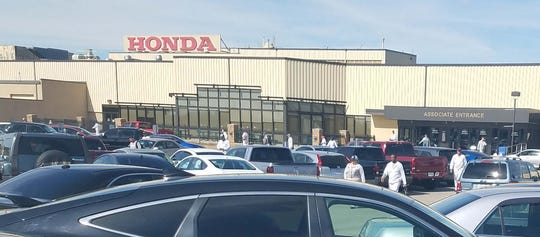 """Honda workers - called """"associates"""" - emerge from the Honda Marysville Plant at the end of the 6:30 a.m.-3 p.m. shift. Marysville's non-union plants haven't had a work stoppage in 40 years."""