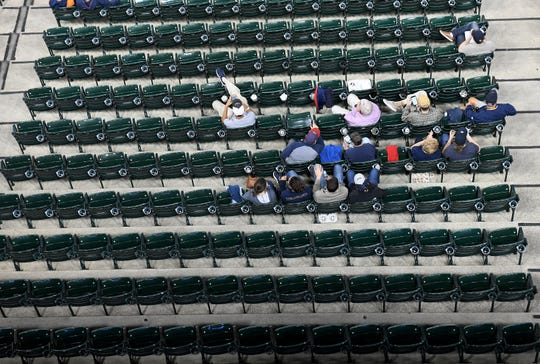 Many empty seats can be seen in section 119 at Comerica Park Tuesday night.
