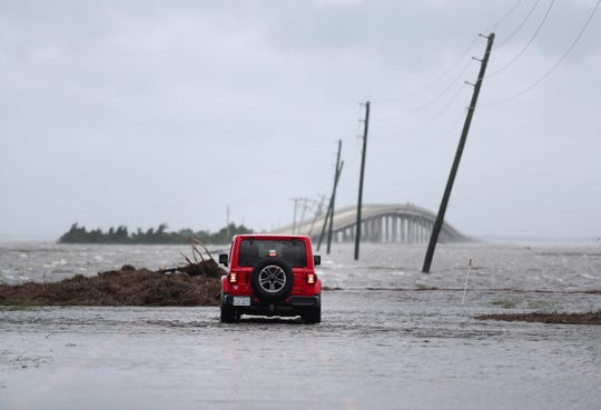 Storm surge from Hurricane Dorian blocks Cedar Island off from the mainland on NC 12 in Atlantic Beach, N.C., after Hurricane Dorian passed the coast. A special United Nations-affiliated oceans and ice report released on Wednesday, Sept. 24, 2019 projects three feet of rising seas by the end of the century, much fewer fish, weakening ocean currents, even less snow and ice, and nastier hurricanes, caused by climate change.