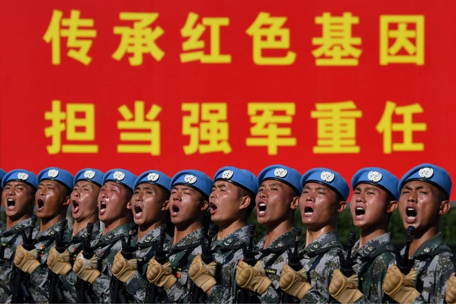 Soldiers practice marching in formation ahead of the military parade to celebrate the 70th anniversary of the founding of the People's Republic of China in Beijing, Wednesday,  Sept. 25, 2019.