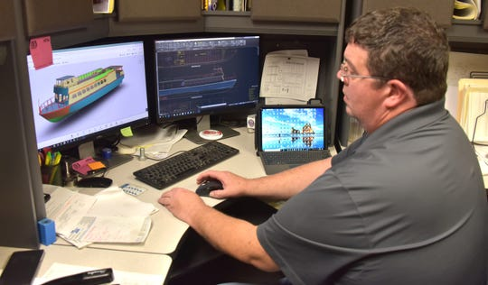 Jason Willis, 45, project manager at the Moran Iron Works in Onaway, Mich., views a computer image of the 84-foot Shepler's ferry, the William Richard.
