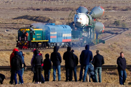 Russia's Soyuz-FG booster rocket with the Soyuz MS-15 space ship that will carry new crew to the International Space Station (ISS) is transported from its hangar to the launch pad at the Russian leased Baikonur cosmodrome, Kazakhstan, Monday, Sept. 23, 2019.