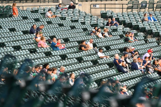 Many empty seats are seen in left field sections 146 and 147 at Comerica Park Tuesday night.