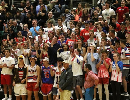 The Corning student section cheers for the Hawks during a 3-2 loss to Horseheads in volleyball Sept. 24, 2019 at Corning-Painted Post High School.