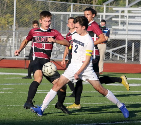 Jakub Ziembicki (9) of Elmira and Matthew Craigh (2) of Binghamton battle for possession in boys soccer Sept. 25, 2019 at Ernie Davis Academy.