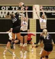 Alexa Waksmunski of Corning goes for the kill as Eva Kurzik (12) and Cameron Hilliard (11) of Horseheads try for the block Sept. 24, 2019 at Corning-Painted Post High School.
