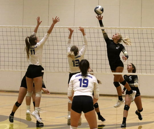Sadie Sharkey of Corning hits the ball over the net in a 3-2 loss to Horeheads in volleyball Sept. 24, 2019 at Corning-Painted Post High School.