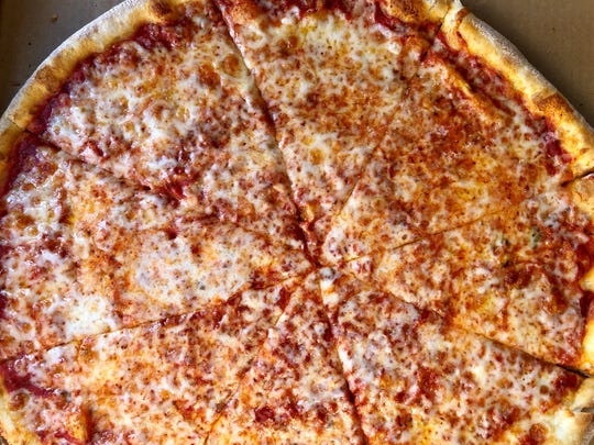 A large cheese pizza ($15.95) from Tony's NY Pizzeria in The Forum.