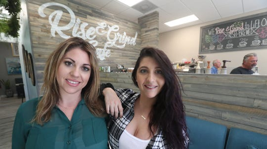 Sisters Maria Torocco, left, and Alaina Basile opened Rise & Grind Cafe Monday in Gateway. It sits next to their brother's restaurant, The Saucy Meatball.