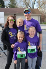 Betsy and Paul LeTourneau with Madyson, 5, top center, and their older daughters  Payton, 8, left, and Ashlyn, 10.