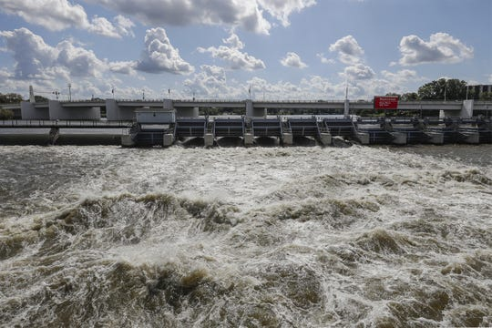 Water surges through the De Pere Dam on Wednesday after the U.S. Army Corps of Engineers increased flow into the Lower Fox River in order to reduce flooding and property damage on Lake Winnebago and upstream rivers and lakes.