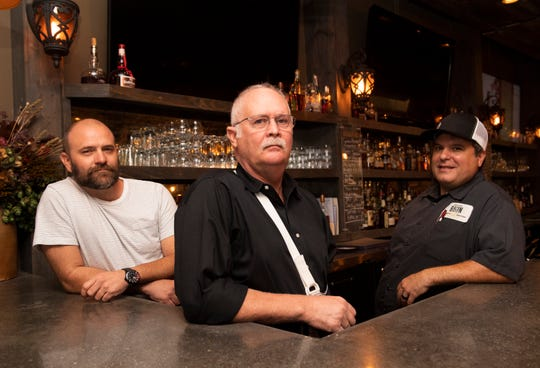 Jason Callaway (from left), Mike Porter and Anthony Gray at Bacon Brothers Public House Wednesday, Sept. 25, 2019.