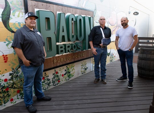 Anthony Gray (from left), Mike Porter and Jason Callaway at Bacon Brothers Public House Wednesday, Sept. 25, 2019.