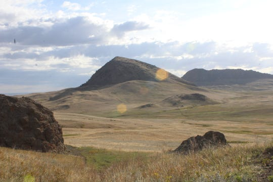 Haystack and Fishback buttes rise above short grass prairie lands west of the Birdtail Butte Conservation Easement