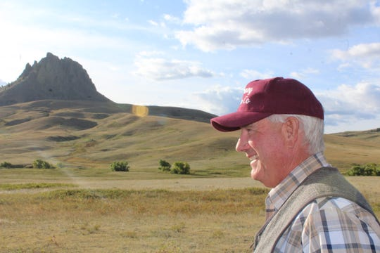 Property owner Bob Rumney greets visitors to his property surrounding Birdtail Butte (shown in the background). Four thousand acres of Rumney's property is now permanently  open to the public within the Birdtail Butte Conservation Easement