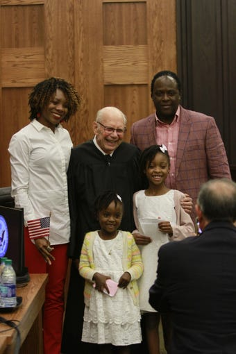 New citizens and their families celebrate at the U.S. District Court Naturalization Ceremony Wednesday, September 25