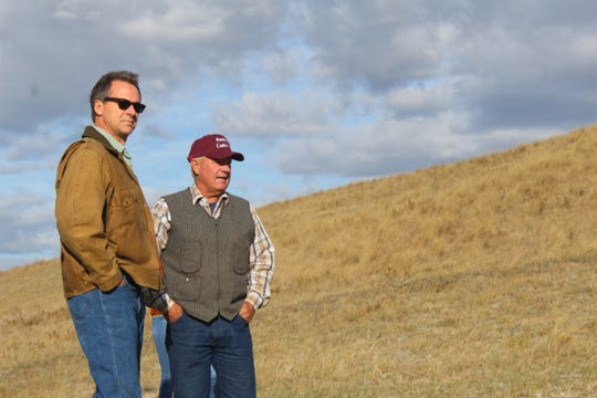 Property owner Bob Rumney (right) escorts Montana Governor Steve Bullock during a recent tour of the Birdtail Butte Conservation Eastement.