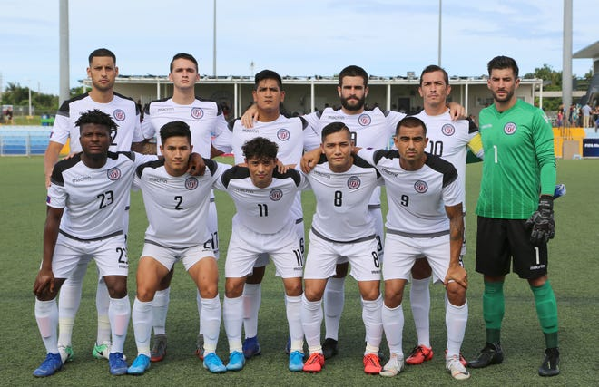 Guam's starting 11 before the team's match against the Philippines in a Round 2 fixture of the FIFA World Cup Qatar 2022 and AFC Asian Cup China 2023 Preliminary Joint Qualification at the Guam Football Association National Training Center. Front, from left: Shane Malcolm, Isiah Lagutang, Dylan Naputi, Mark Chargualaf and Marcus Lopez. Back, from left: Travis Nicklaw, Joseph Ciochetto, Ian Mariano, Michael Crowley, Jason Cunliffe and Dallas Jaye.