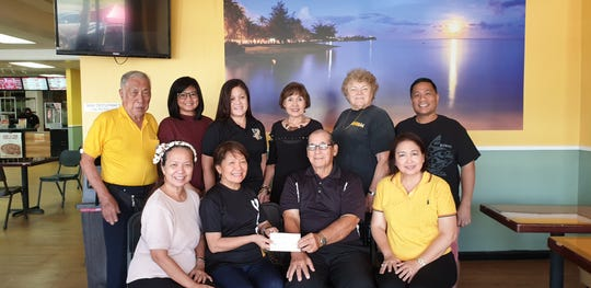 The University of Santo Tomas Alumni Organization of Guam presented a yearly donation to the Guam Diabetes Association to help fund the 20th annual Guam diabetes conference. Pictured from left: Glynis Almonte, Dr. Yolanda Carrera, Scott Duenas, Del Agahan. Back row: Alan Wang, Dr. Melliza Young, Dr. Alma Domingo, Winnie Butler, Ginny Caceres and Patrick Luces.