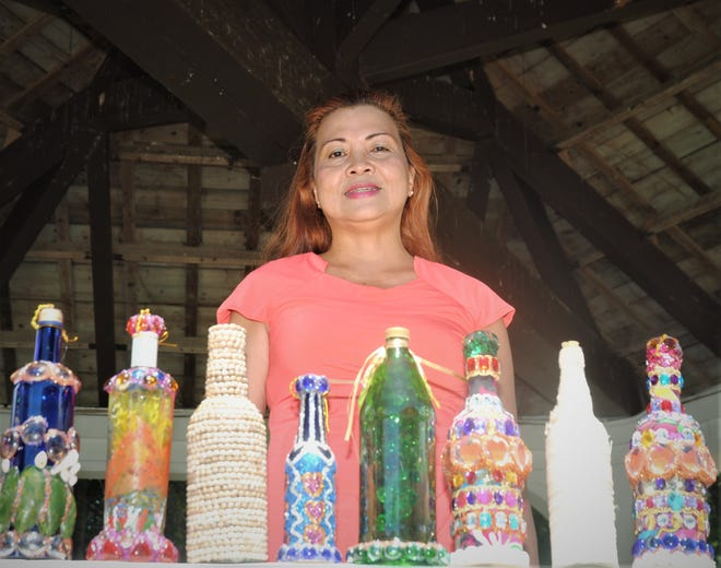 Elizabeth Abuan presides over some of her creations.