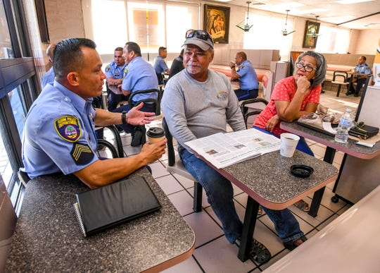 Couple, Joe and Maggie Cruz, spend part of their morning chatting with Guam Police Department officer, M.J. Winn, during a Coffee With a Cop community outreach at the McDonald's of Guam in Hagåtña on Wednesday, Sept. 25, 2019. During the event, held in partnership with McDonald's of Guam, stakeholders in the community were able to casually sits with public law enforcement officers to express safety concerns. Another gathering is being scheduled to be held on Oct. 3, in conjunction with the International Coffee With a Cop program, at the Tamuning, Hagåtña, Harmon and Yigo restaurant locations from 7:30 a.m. to 9:30 a.m., according to Divina Evaristo, McDonald's marketing consultant. For more images, check out a gallery posted at GuamPDN.com.