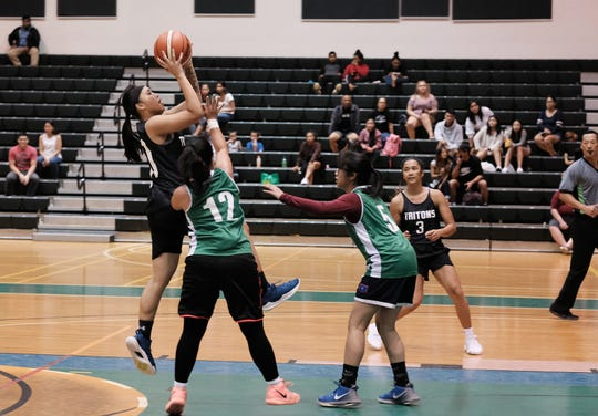 Tritons player Jan-Nasia Tavilla finds an opening among Tridents defenders in an 82-28 rout Sept. 23 in the PBS Guam Women's Basketball League.