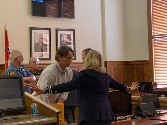 Victor Mitchell talks with his attorney Tangi Carter after a day of testimony Tuesday, Sept. 24, 2019, at Pearl River County Courthouse.