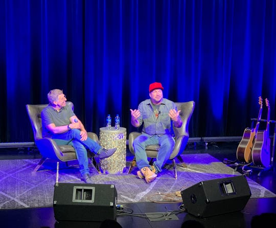 """Bob Santelli, the founding executive director of the GRAMMYMuseum and moderator for the museum's """"Backstage Pass"""" series program, interviews country music legend Garth Brooks Tuesday, Sept. 24 2019 at the GRAMMY Museum Mississippi in Cleveland."""