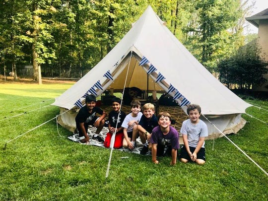 A campaign-style outdoor tent, set up by Upcountry Camp, provided a setting for a birthday party for Jonah Kerr of Ridgeland. From left are Sanjay Reddy, Sonu Sethi, Max Newman, Cobb Hendrix, Jonah Kerr and Keifer Freeman.