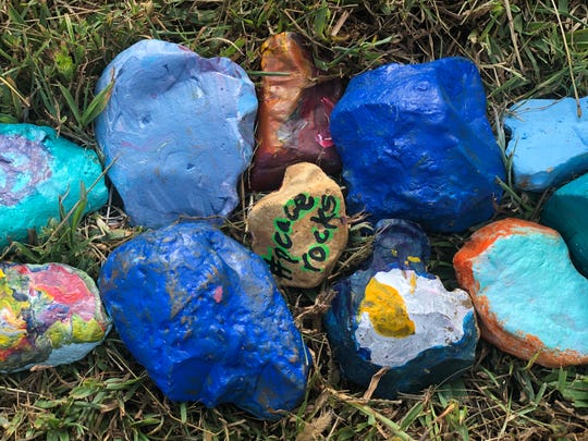 "Some rocks had #PeaceRocks. If anyone finds one, Janie Carp, CMS art teacher, encouraged people to post a picture on Facebook and Instagram with that hashtag and re-hide the rocks to continuously spread peace. ""I'm just curious how far the rocks might go,"" she said."