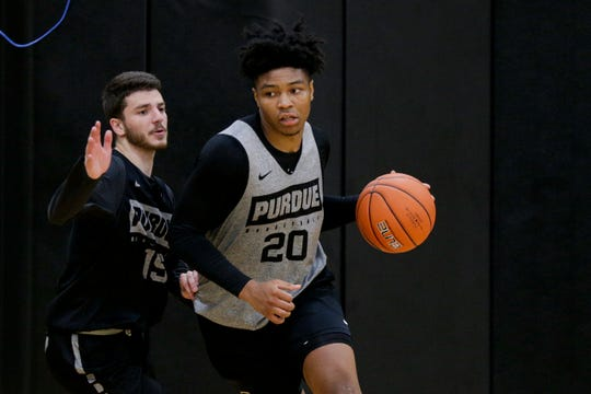 Purdue guard Nojel Eastern (20) dribbles around Purdue guard Tommy Luce (15) during practice, Wednesday, Sept. 25, 2019, at Mackey Arena's Cardinal Court in West Lafayette.