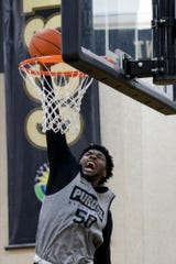 Purdue forward Trevion Williams (50) goes up for a dunk Wednesday, Sept. 25, 2019, at Mackey Arena's Cardinal Court in West Lafayette.