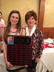 Brittany Gosserand was the David Trosclair Scholar in 2016, her senior year at the University of Louisiana at Lafayette. She stands with Carol Trosclair, whose late son David is memorialized by the scholarship.