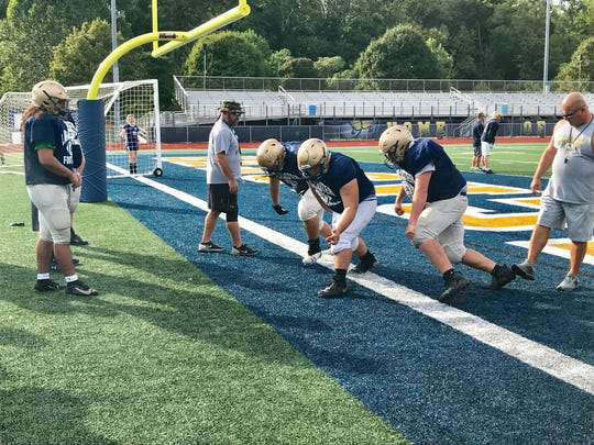 Lancaster assistant coaches Tony Albertini and Mont Goss put the offensive linemen through drills during Tuesday's practice at Fulton Field.