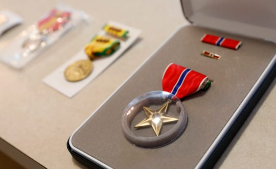Greg Fox's Bronze Star sits next to other medals he received for his military service in Vietnam.