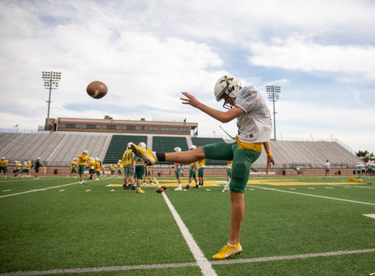 Jeffrey Sexton takes some punting practice Tuesday, Sept. 24, 2019 in Louisville Ky. After graduation, Sexton will go on to kick for a new Tiger team next year, Princeton.