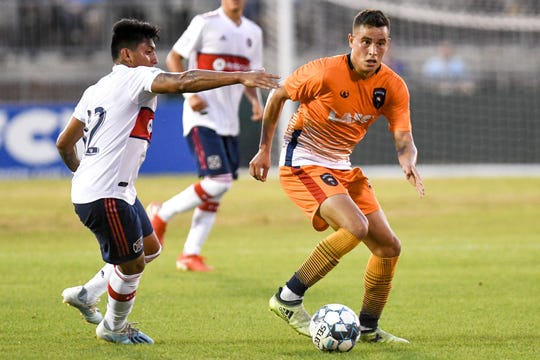Lansing Ignite's Xavier Gomez, right, moves past Chicago Fire's Amando Moreno during the first half on Tuesday, Sept. 24, 2019, at Cooley Law School Stadium in Lansing.