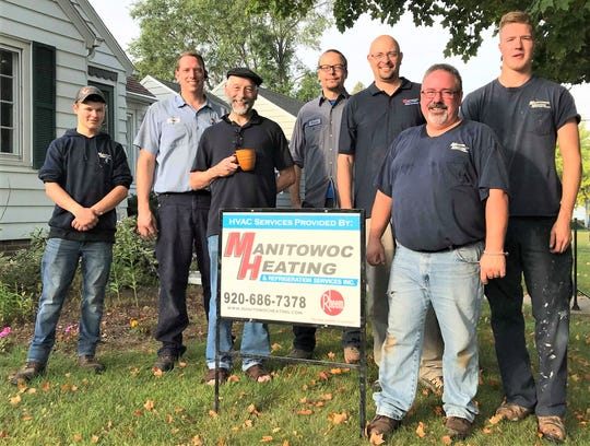 """Charlie Kurth won a free furnace during Manitowoc Heating's """"Bringing the Heat"""" event."""