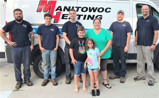 """Alison Backus won a free furnace during Manitowoc Heating's """"Bringing the Heat"""" event."""