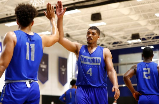 Memphis Tigers forward Isaiah Stokes, right, high-fives Lester Quinones during practice at the Laurie-Walton Family Basketball Center on Tuesday, Sept. 24, 2019.