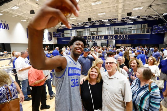 Memphis center James Wiseman takes a selfie with fans after practice Sept. 24.