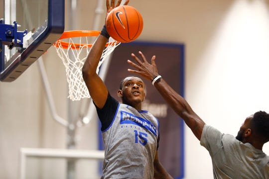 Memphis Tigers forward Lance Thomas blocks a shot during practice at the Laurie-Walton Family Basketball Center on Tuesday, Sept. 24, 2019.