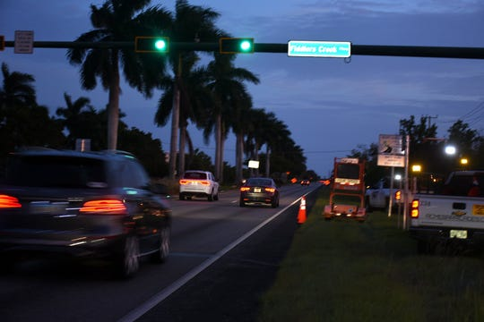 Workers lay out cones to shut down one lane of southbound 951. A work project along Collier Blvd., including long-awaited smoothing out of a bumpy roadway, has commenced in what will be a year-long process, with work primarily at night.