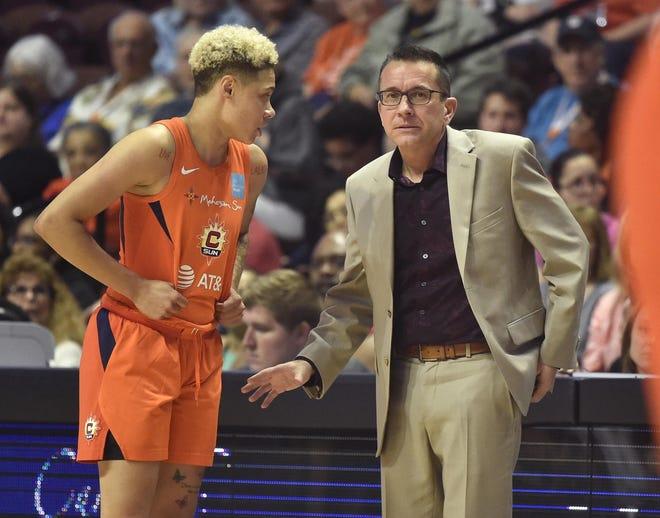 Connecticut Sun guard Natisha Hiedeman, a former Marquette standout, speaks with head coach Curt Miller.