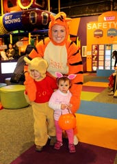 Families dress in costume at Not-so-Scary Halloween at Betty Brinn Children's Museum.