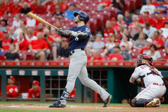 Ryan Braun watches his grand slam off Reds starting pitcher Tyler Mahle sail toward the right-center field stands Wednesday.