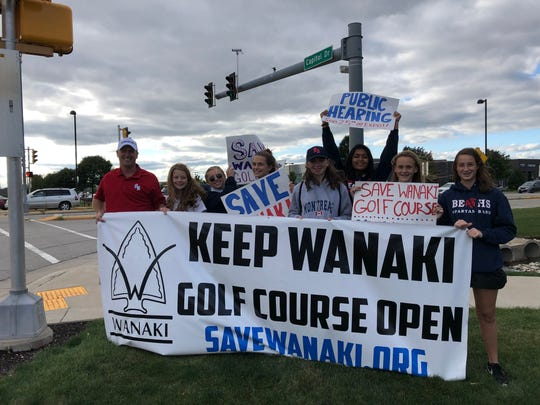 Since Waukesha County officials announced the closing of Menomonee Falls' Wanaki Golf Course, community members have been working to keep it open through the Save Wanaki campaign. Members of the Brookfield East girls golf team promoted awareness at Capitol Drive and Brookfield Road on Sept. 13. Pictured are (from left) coach Chris Minchk, Isa Zuniga-Meyer, Grace Schulz, Jenny Austin, Lily Schick, Mahika Mohan, Josie Clegg and Reagan Vander Heide.