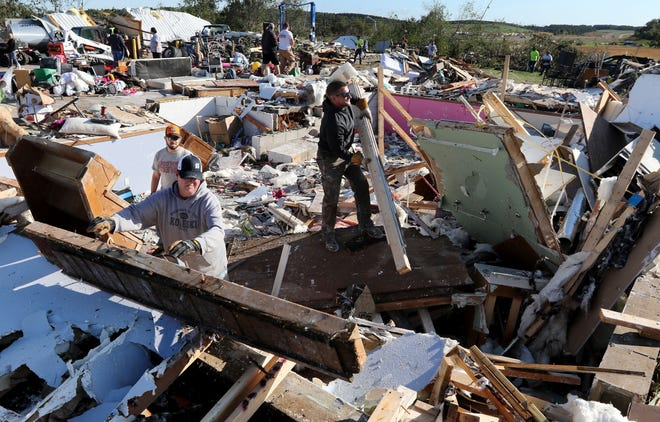 Volunteers helped clear debris from a home which was demolished by a tornado that hit Tuesday evening, Sept. 25, 2019 in the town of Wheaton, just off Wisconsin Highway 29 in Chippewa County. At least one confirmed tornado touched down as severe storms ripped through western Wisconsin on Tuesday, damaging homes and other structures near the Chippewa-Dunn county line.