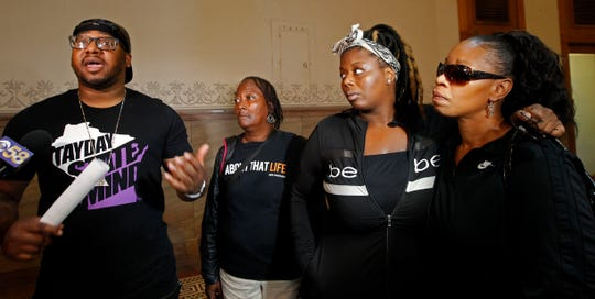 Vaun Mayes, left, speaks at a news conference at City Hall Wednesday about the rising violence in Milwaukee. Joining Mayes are Farina Brooks, Wanona Thomas, second from right, with her mother, Ronica Banks. They are the sister and mother of Jasmine Banks, who was recently killed when she drove into a crossfire.